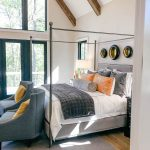 master bedroom with vaulted beamed ceilings - Luxury Modern Farmhouse