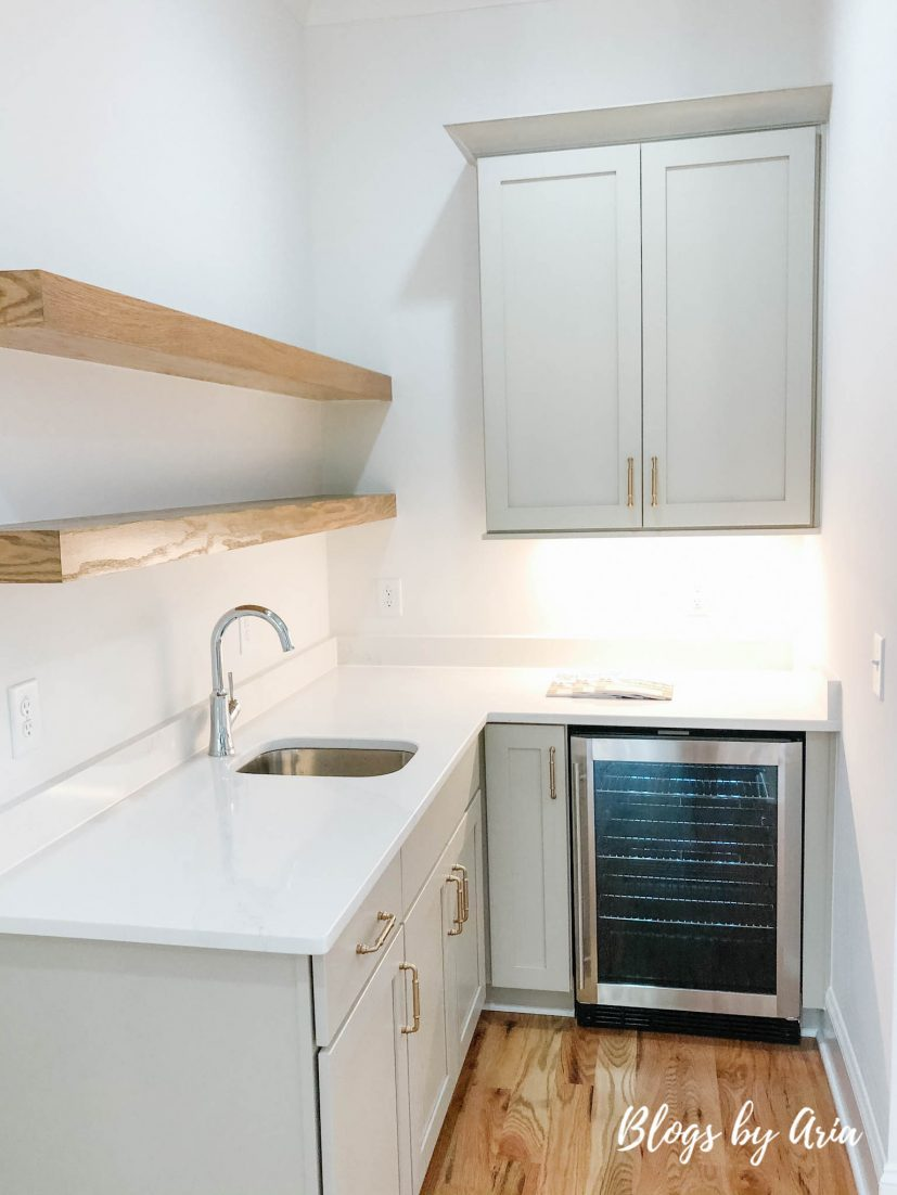 butler's pantry with floating shelves