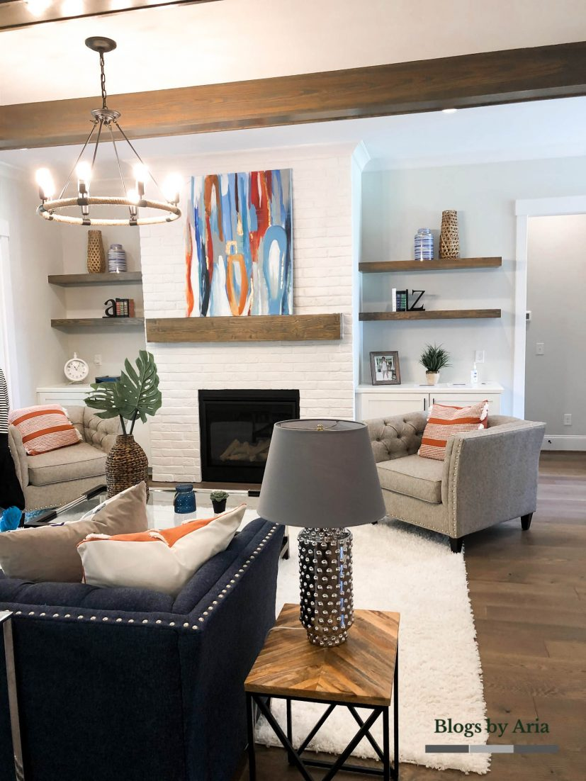 modern farmhouse living room design with white painted brick fireplace