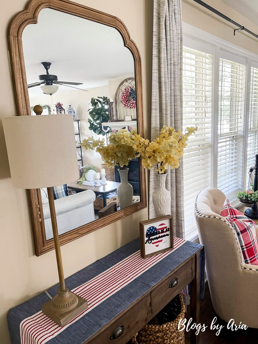 entryway table with red, white and blue runner